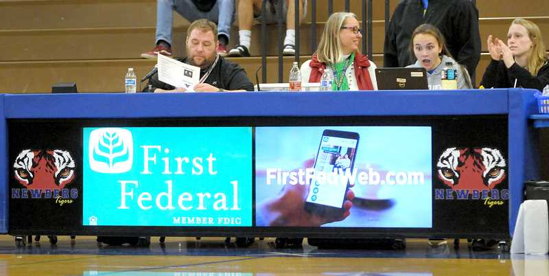 SETH GORDON - Newberg High School's new scorer's table was made possible by a partnership between the school and a promotional company called Side Effects.