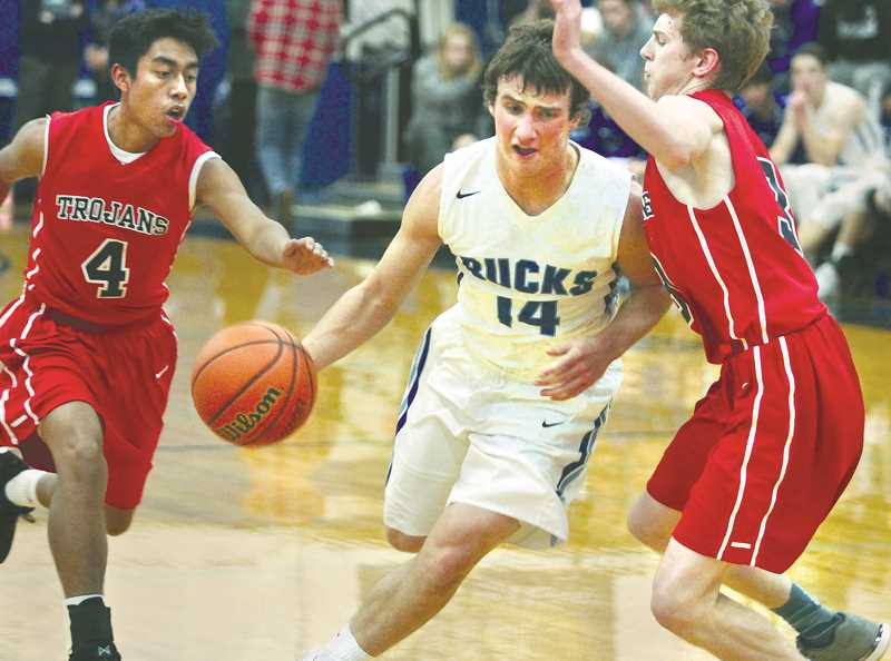 PHIL HAWKINS - WOODBURN INDEPENDENT - Justin Herberger drives to the basket in the Bucks' loss to Kennedy on Dec. 19 at home.