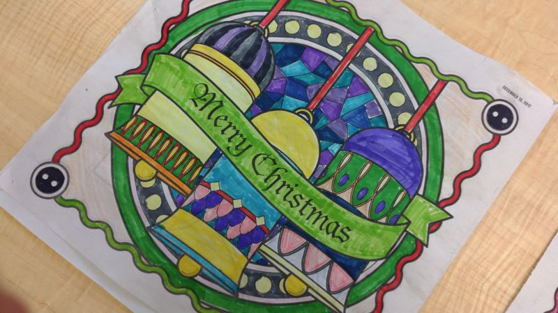 NEWS-TIMES PHOTO: STEPHANIE HAUGEN - Novalee Johnston used both traditional and non-traditional colors of Christmas to make these bells on the coloring page ring. She was a first-place winner in this year's contest.