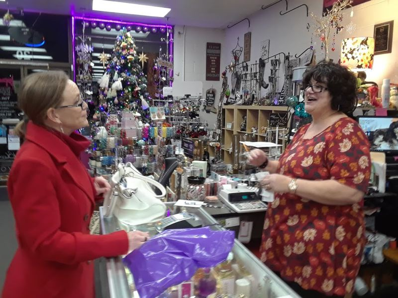 OUTLOOK PHOTO: SHANNON O. WELLS - Sandy resident Kim Young chats with Accent on Attitude store owner Judy Wylie while purchasing gifts the week before Christmas Day. Wylie said the last couple of holiday shopping seasons have been strong in downtown Gresham.