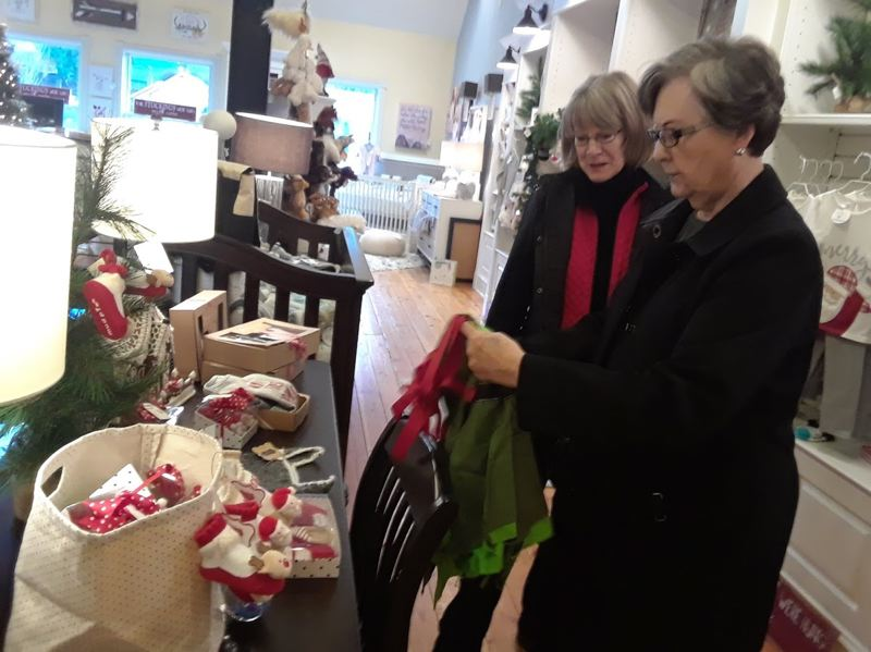 OUTLOOK PHOTO: SHANNON O. WELLS - Cat Briehl and Nora Strand came from the Ridgefield, Wash., area to check out holiday-themed gift ideas at Celebrate Me Home in downtown Troutdale on Wednesday, Dec. 20.