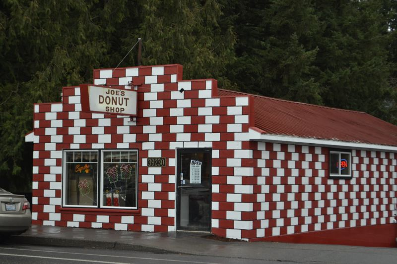 POST PHOTO: BRITTANY ALLEN - The iconic red and white paint job of Joe's Donut Shop lives on. The city of Sandy's Facade Improvement Program recently helped retouch the paint and make other improvements to the long-time Sandy institution.