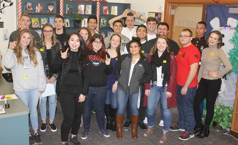 SUSAN MATHENY/MADRAS PIONEER - MHS grads, now in college, who returned to speak to high school students included, from back left, Tristan Bateman, Jordan Bennett (not from MHS), Omar Dominguez, Miklo Hernandez, Ryan Leriche, Obed Eriza, Daren Shaw, Colton Goss and Terrell Wallalutum. Front row, from left, Elle Renault, Taylor Sjolund, Dacota Ashwill, Danielle Schmaltz (at back), Nishell Abbe, Carly Breach, Vanessa Aguirre, Nikkola Prevett, Jeremy Stinson and Lizzie Wienert.
