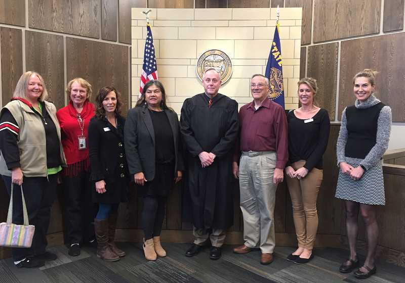SUBMITTED PHOTO - At the CASA swearing-in at Madras were, from left, Patti Carpenter and Judy Harris, advocates, Meriah Williams, program coordinator, new advocate Jolene Estimo Pitt, Circuit Court Judge Daniel Ahern, new advocate Floyd Courtain, Sarah Graziani, training coordinator, and Jenna App, executive director.