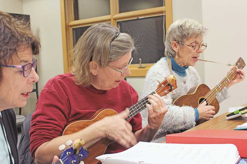 SPOKESMAN FILE PHOTO - Ten to 20 people show up to the Wilsonville Community Center Wednesday nights to play a selection of ukulele classics and modern adaptations, led by Timark Hamilton.