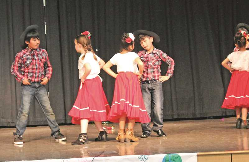 SPOKESMAN FILE PHOTOS - Members of Lowrie Primarys baile folklorico perform during an International Day celebration in May.