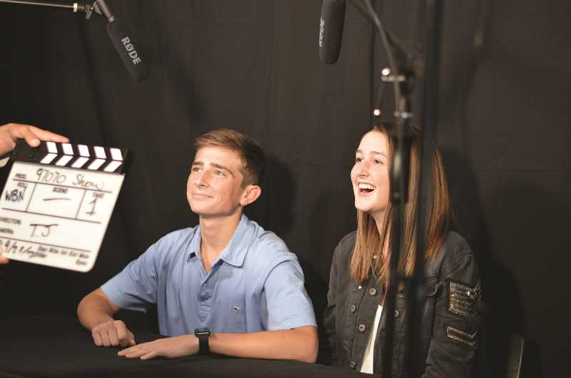 SPOKESMAN FILE PHOTOS - Seniors Brett Thompson (left) and Mary Kimball (right) film the sports show, 97070 during class. The teens were enrolled in a broadcast journalism class at Wilsonville High School