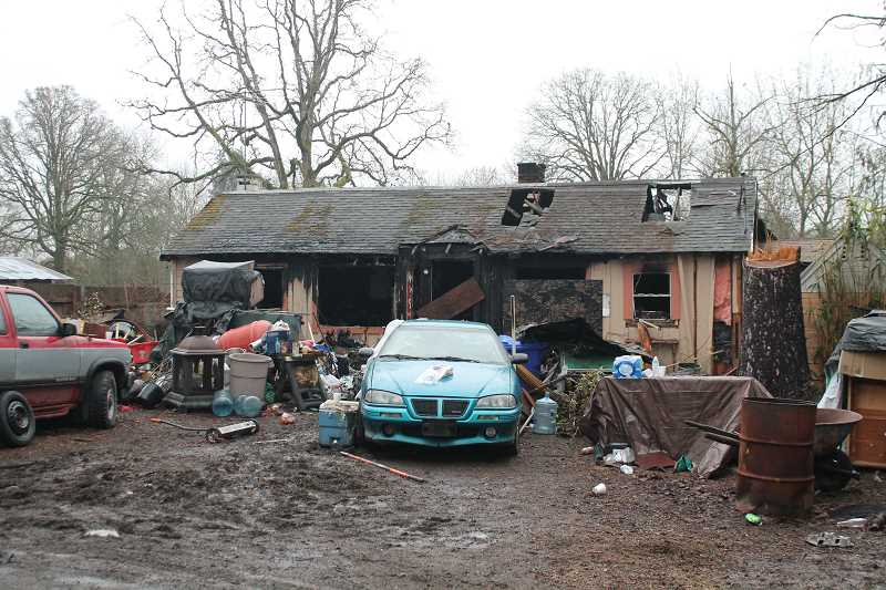 PIONEER PHOTO: CONNER WILLIAMS - A fire destroyed a Molalla-area home and killed the owner's pets on the morning of Christmas Eve.