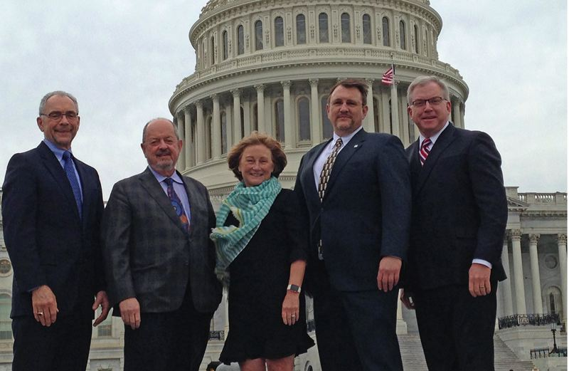 COURTESY: WESTSIDE ECONOMIC ALLIANCE - Mayor Lou Ogden of Tualatin, Mayor Denny Doyle, Beaverton, Pam Treece WEA, Don Odermott, City of Hillsboro and Jonathan Schlueter, Washington County, making it rain in DC.