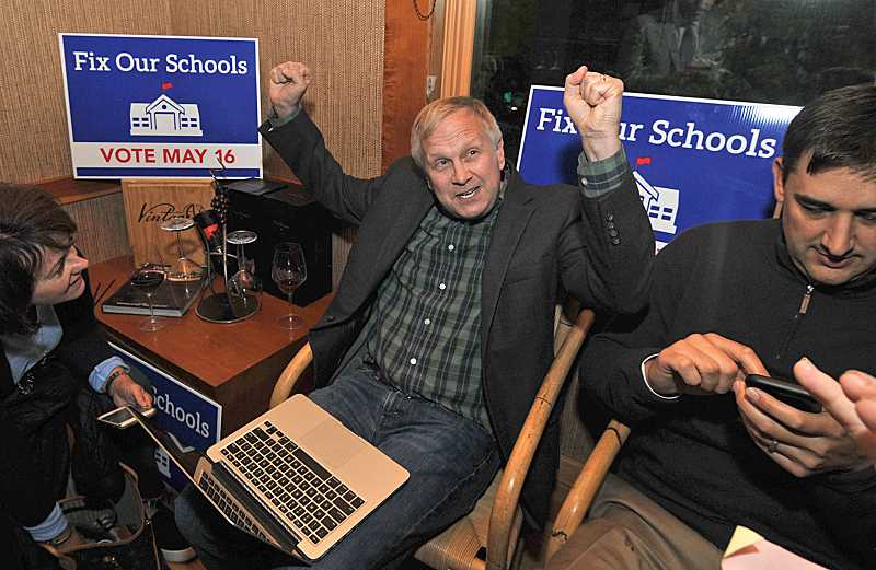 REVIEW PHOTO: VERN UYETAKE - Lake Oswego School Board Chair John Wallin celebrates in May after early returns showed the district's $187 million bond measure passing easily.