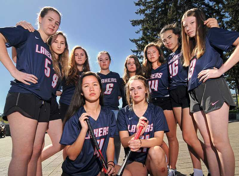 REVIEW PHOTO: VERN UYETAKE - Members of the Lake Oswego High softball team filed a federal Title IX lawsuit against the Lake Oswego School District in 2016, saying they had been denied equal access to the kinds of equipment, facilities, funding and fundraising opportunities provided to the boys baseball team. In October, the district settled the lawsuit by agreeing to most of the team's demands.