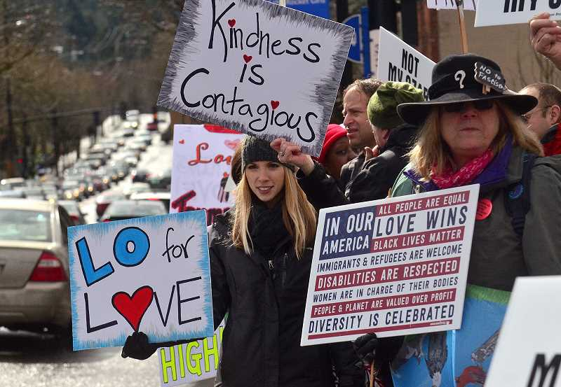 REVIEW PHOTO: VERN UYETAKE - Stand for LOve supporters line State Street in March as pro-Trump marchers make their way down the opposite side of the street. The crowd chanted and held protest signs, but remained otherwise peaceful before returning to Millennium Plaza Park in the afternoon.