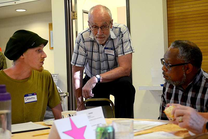 REVIEW PHOTO: VERN UYETAKE - Dakota Gonzalez (from left), David Dunning and Bruce Poinsette chat during a recent Respond to Racism meeting. Each of the monthly gatherings has seen a large returning crowd, as well as many new faces.