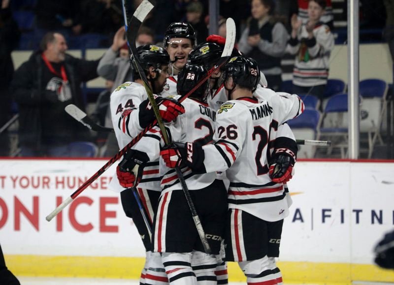 TRIBUNE PHOTO: JONATHAN HOUSE - The Portland Winterhawks celebrate one of their goals in a 6-3 loss at home Wednesday night to the Tri-City Americans.