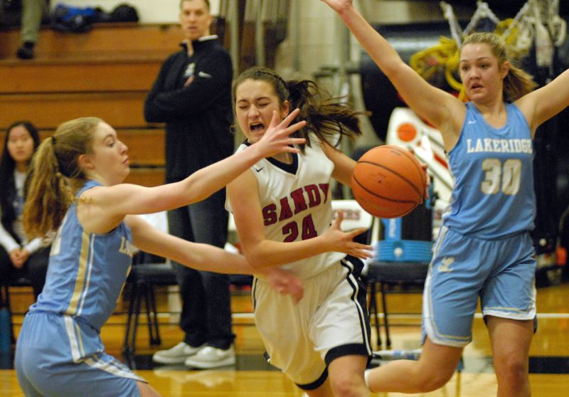 SANDY POST: MATT RAWLINGS - Sandy's Brooklyn Adams goes through a double-team and tries to get to the rack.