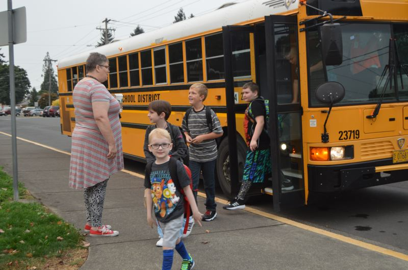 SPOTLIGHT FILE PHOTO - Students get off the bus on the first day of school in September. St. Helens reopened Columbia City Elementary School at the start of the school year for the first time since it was shuttered in 2012.
