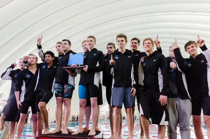 HILLSBORO TRIBUNE FILE PHOTO: CHASE ALLGOOD - Members of the Hilhi Spartans boys swim team accepts their medals for winning the 5A team championship at the OSAA State Swimming Championships last winter at Mt. Hood Community College.