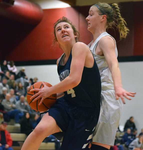 SPOKESMAN PHOTO: TANNER RUSS - Junior Teagan McNamee had a big game against Canby, energizing the Wilsonville offense when it needed it. Still, Wilsonville fell to Canby 57-43.