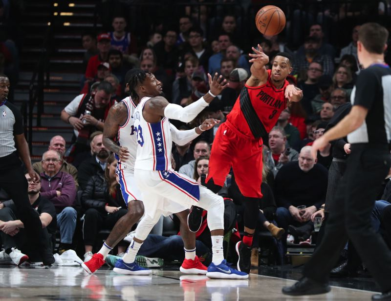 TRIBUNE PHOTO: JAIME VALDEZ - Trail Blazers guard CJ McCollum passes the ball before going out of bounds Thursday night against Philadelphia.
