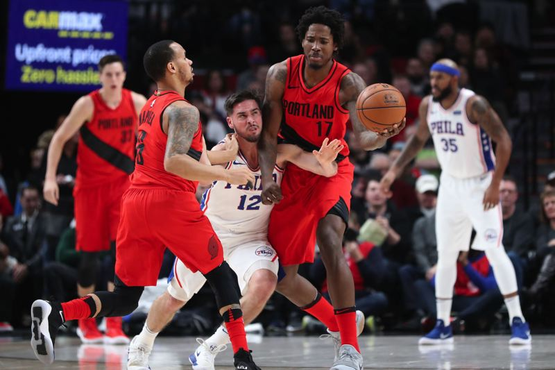 TRIBUNE PHOTO: JAIME VALDEZ - Portland's Ed Davis tries to keep the handle as Philadelphia's T.J. McConnell reaches in during the Thursday night game at Moda Center.