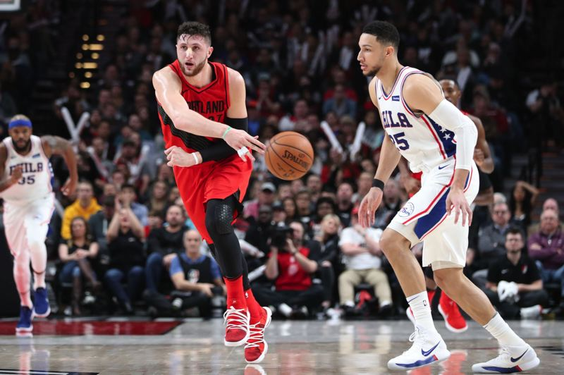 TRIBUNE PHOTO: JAIME VALDEZ - Blazers center Jusuf Nurkic passes the ball past 76ers guard Ben Simmons.