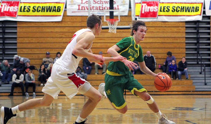 TIDINGS PHOTO: MILES VANCE - West Linn senior Jalen Thompson makes a move during his team's opening-round win over Oregon City in the Les Schwab Invitational at Liberty High School.