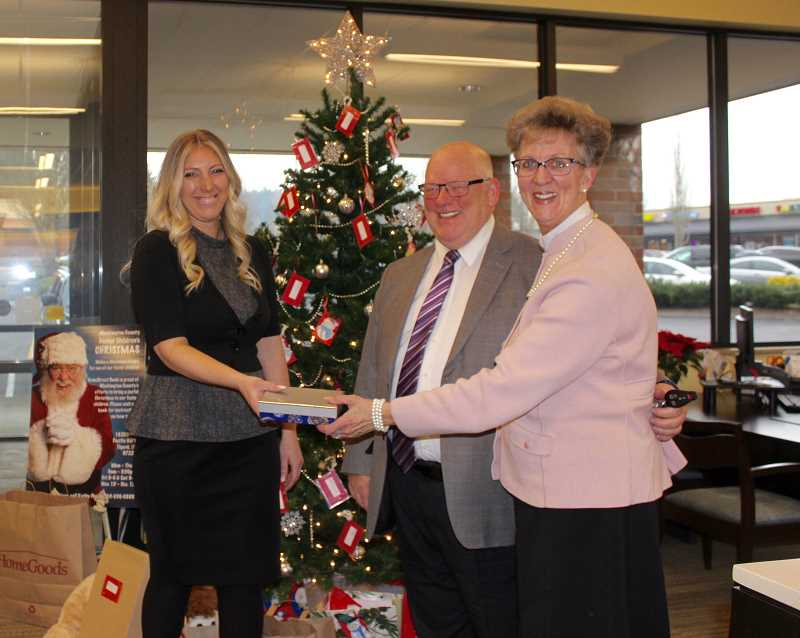 THE TIMES: MANDY FEDER-SAWYER - HomeStreet Bank Manager Haley Richardson thanks Ron and Deborah Threadgill from Threadgills Memorial Services, who donated gift cards for foster youth.