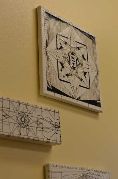 SPOKESMAN PHOTO: CLARA HOWELL - Junior Eleanor Karrick has eight geometric pieces hanging in Principal Dan Schumaker's office.