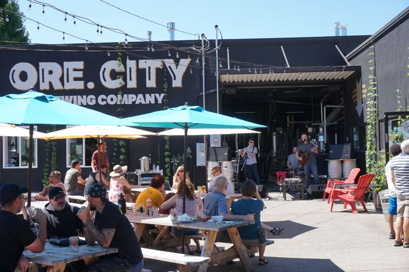 PHOTO COURTESY: DOWNTOWN OREGON CITY ASSOCIATION - Oregon City Brewing Company has transformed a dilapidated used car lot into a vibrant family-friendly community gathering spot.