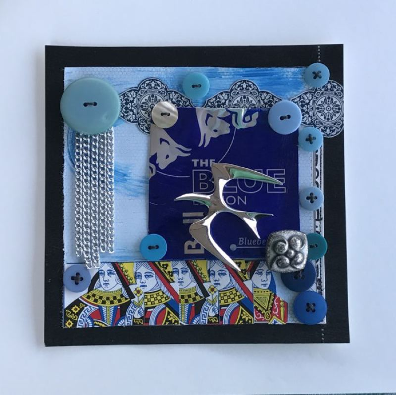 SUBMITTED PHOTO - In 'Silver Rain Over blue Queens,' Beavercreek artist Lindy Rutherford put together buttons, jewelry and other items to create this collage.