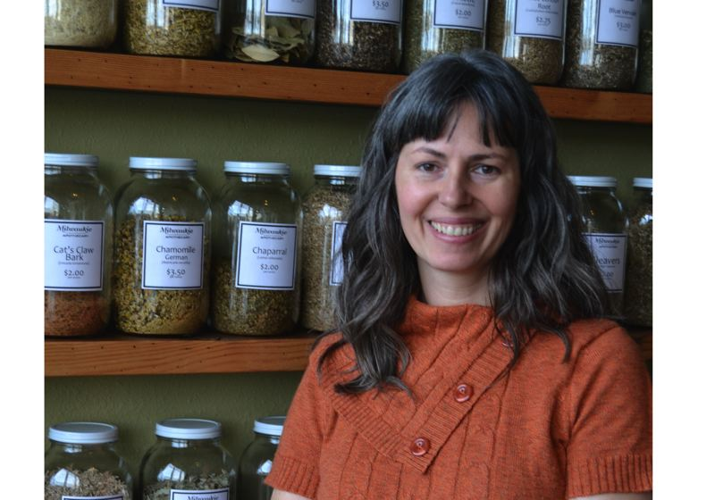 PHOTO BY: RAYMOND RENDLEMAN - Branda Tiffany, who started the Molly Muriel wholesale product line 15 years ago, stands in front of the bulk herb section now bearing the Milwaukie Apothecary name in the downtown store.