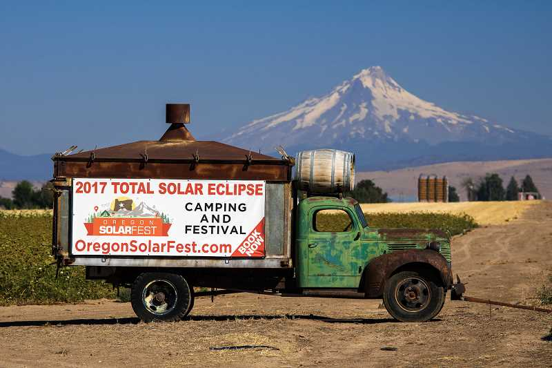 DAVID BROWNELL - The Oregon SolarFest, which featured camping and RV parking at the Jefferson County Fairgrounds, was advertised on a truck sign, north of Madras.