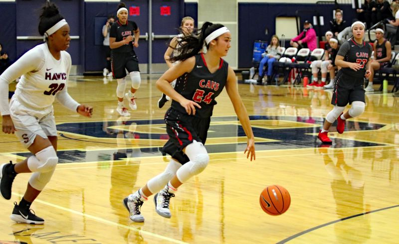 REVIEW/NEWS PHOTO: JIM BESEDA - Clackamas' Alyson Miura returned to the Cavaliers' lineup agaisnt Southridge in Friday's Nike Interstate Shootout semifinals at Lake Oswego High School.