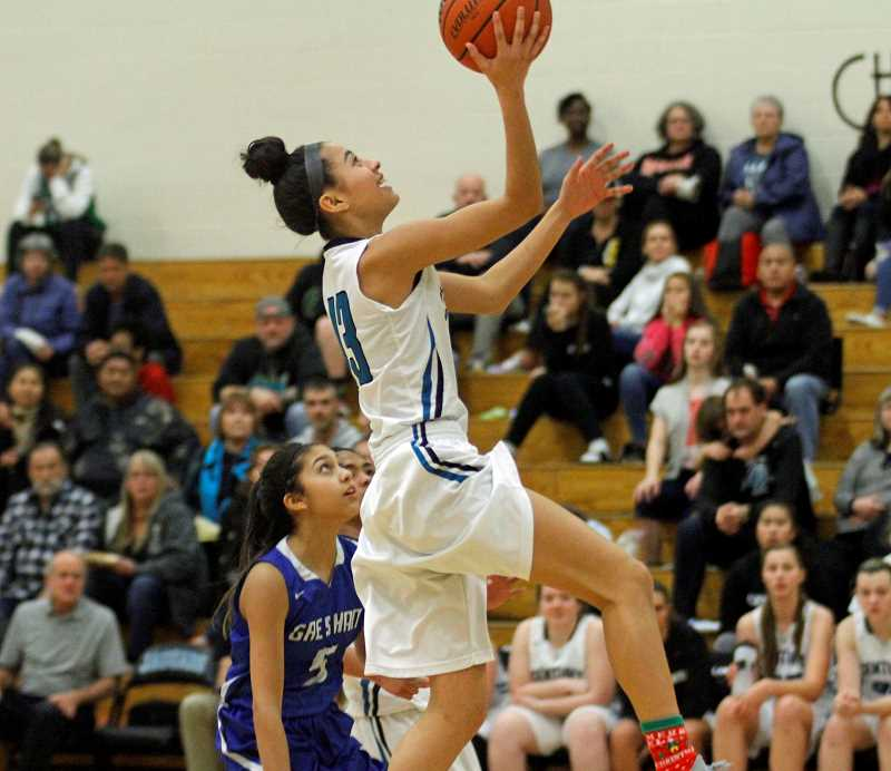 HILLSBORO TRIBUNE PHOTO: WADE EVANSON - Century's Angie Baltazar goes up for a lay-in during the Jaguars' 66-16 win over Gresham in the Century/Hillsboro Holiday Tournament Dec. 28 at Century High.
