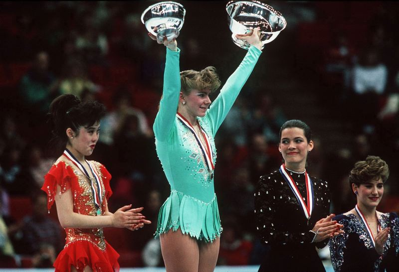 TIM DEFRISCO/ALLSPORT - Tonya Harding celebrates winning the 1991 U.S. figure skating championship, with Kristi Yamaguchi (left) the runner-up and Nancy Kerrigan (right) in third place. Harding's post-skating career include a stint as a boxer, and now her story is brought back to life in a movie starring Margot Robbie.