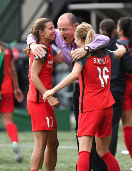 TRIBUNE FILE PHOTO: JOSH KULLA - Portland Thorns owner Merritt Paulson (center) celebrates the team's playoff victory over Orlando with players Tobin Heath (left) and Emily Sonnett.