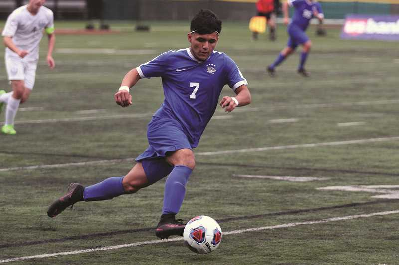 PHIL HAWKINS - Woodburn junior Jesus Rodriguez earned First Team All-State honors after scoring 23 goals and dishing nine assists, the last of which went to fellow First Team teammate Salvador Perez, who scored the game-tying goal against Corvallis in the 5A State Championship in November.
