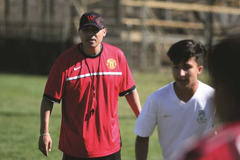 PHIL HAWKINS - Woodburn first year head coach Leroy Sanchez was named 2017 5A Coach of the Year for taking over a boys soccer program that had lost 11 seniors to graduation and guiding it to a second consecutive state championship.