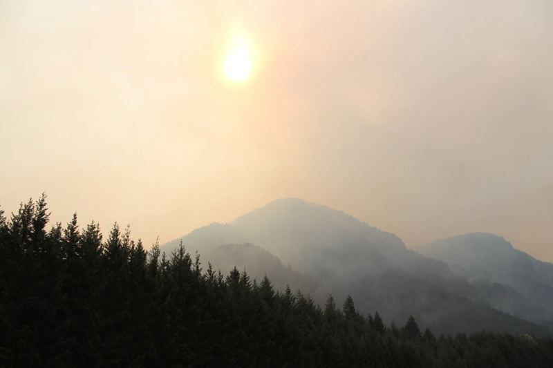 FILE - Smoke from the Eagle Creek fire turned the sun into a burnt-orange orb in the sky for days late last summer.