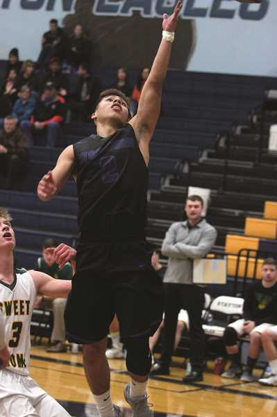 PHIL HAWKINS - Woodburn senior Jaime Tlatenchi goes up for a pair of his five points scored in the first quarter of the Bulldogs' 66-49 win over the Sweet Home Huskies on Thursday at the Stayton Holiday Tournament.