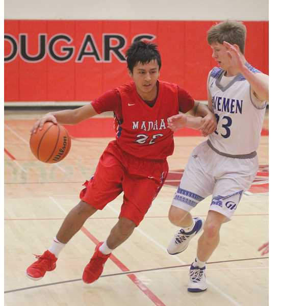 WILL DENNER/MADRAS PIONEER - Madras sophomore Donnie Bagley (left) poured in seven points against Grants Pass on Sunday. The night before, Bagley was one of five Madras underclassmen who played out the final four minutes against Ridgeview, while the rest of the team had either fouled out or checked out of the game due to injury. Madras won the game 90-80.