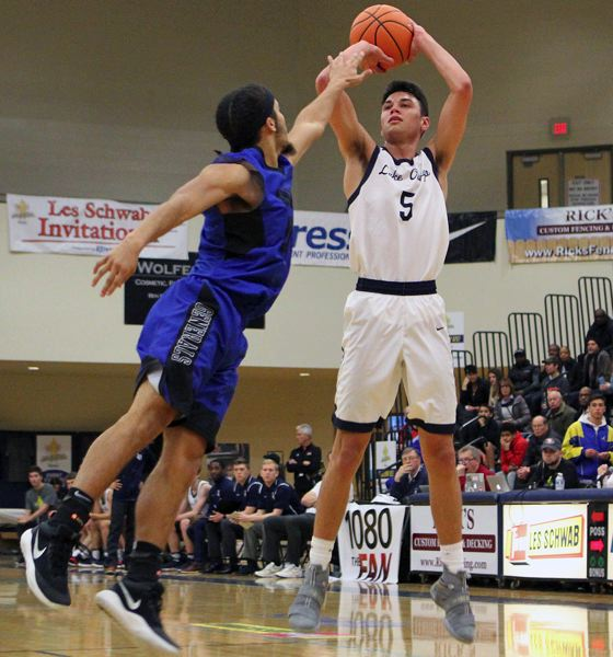 REVIEW PHOTO: MILES VANCE - Lake Oswego senior J.R. Schilling rises up for a shot in his team's Les Schwab Invitational opener against Grant on Dec. 27.