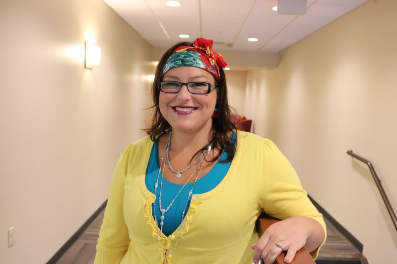OUTLOOK PHOTO: ZANE SPARLING - Omica Hudson, a social studies teacher at Centennial Middle School, said the opportunity to study in Cyprus changed her as a person and a teacher. Here she dons a bright scarf and earrings, both hand embroidered and purchased at a Cyprus market.