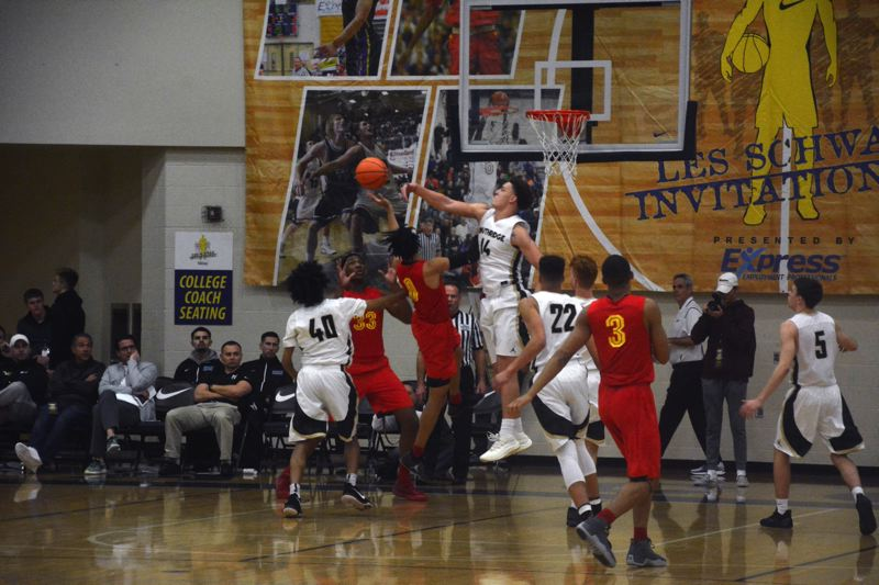 TIMES PHOTO: MATT SINGLEDECKER - Southridge senior Bradley Bickler blocks a shot in the first quarter of the Les Schwab Invitational against Oak Hill Academy.