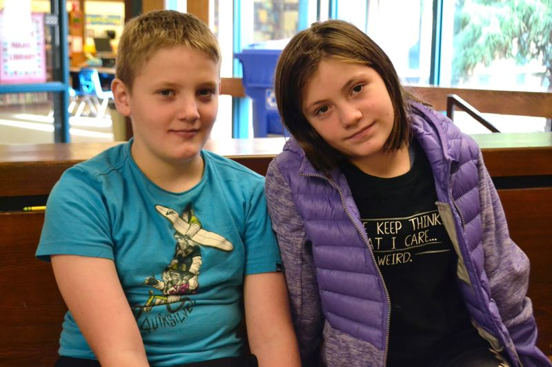 POST PHOTO: BRITTANY ALLEN - Grant and Kelsey Shupe are like night and day and enjoy being in separate classes at Naas Elementary School.