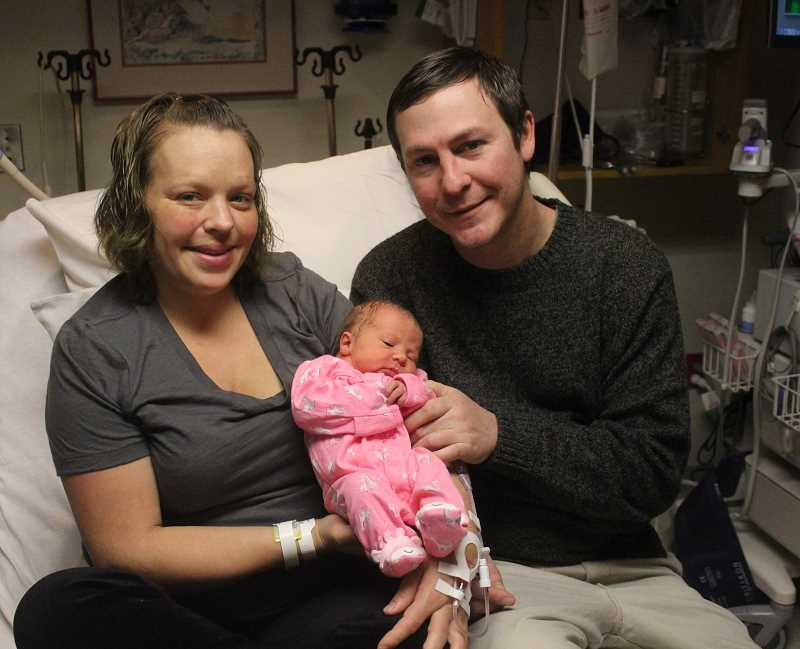 SUSAN MATHENY/MADRAS PIONEER - Parents Toni Smith and Aaron Ahern hold baby Khloe at the hospital.
