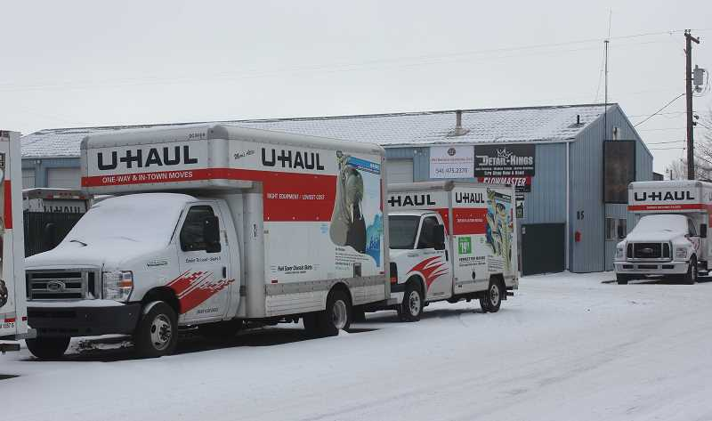 SUSAN MATHENY/MADRAS PIONEER - A variety of U-Haul trucks are lined up outside the business.