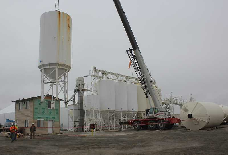 SUSAN MATHENY/MADRAS PIONEER - A crane hoists one of the old fertilizer tanks out of position to make way for a new tank.