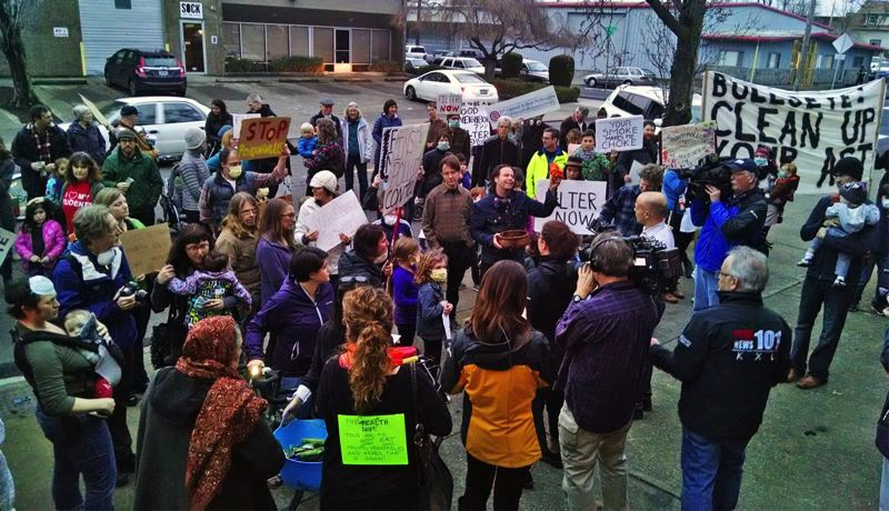 PAMPLIN MEDIA GROUP FILE PHOTO - Neighbors and others rallied outside Bullseye Glass Co. in Southeast Portland to protest industrial pollution from the plant. A new state audit says the state Departmento of Environmental Quality's backlog of permits could endanger state air quality in some places.
