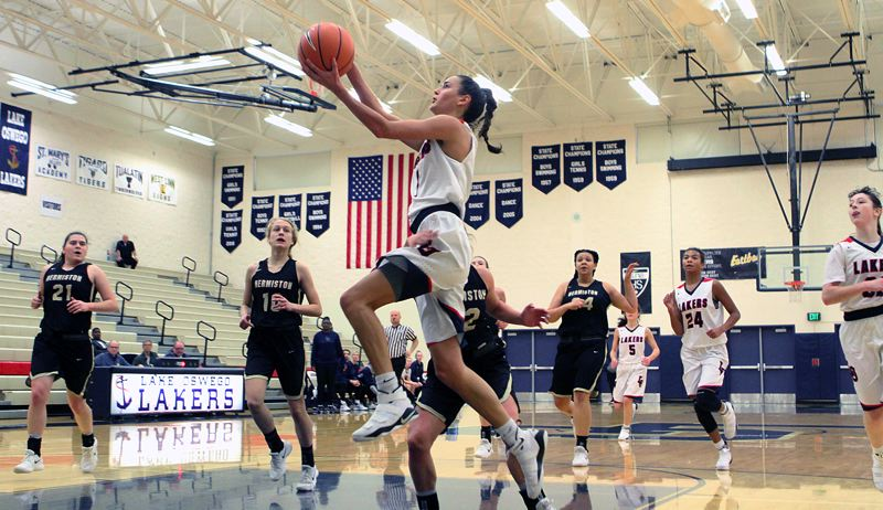 REVIEW PHOTO: MILES VANCE - Lake Oswego junior Taylor Anders soars to the basket during her team's 37-35 loss to Hermiston in the second round of the Nike Interstate Shootout at Lake Oswego High School on Dec. 28.